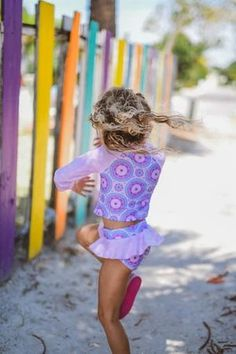 Girls Bathing Suits - Purple Medalia Let her spend her days catching rays and splashing away in our uniquely designed lovable Kryssi Kouture Exclusive swimsuits! Our swimsuits come in a style for every little & big gal.