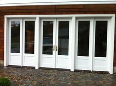 Converting A Garage Into A Living Space Brick Wall White Glass Door Stone Flooring