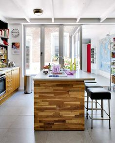 so much light! marble topped butcher block island, rolling pantry and a map of the world