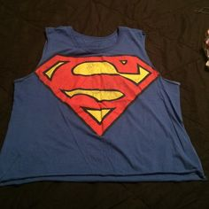 MUSCLE TEE... Cute superwoman tee..styled wth some cute jeans n sandals.. Forever 21 Tops Muscle Tees
