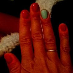 Missing my long nails :( Couple of weeks and they'll be back. Big Apple Red by OPI and Mint Candy Apple by Essie.