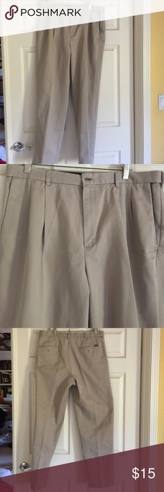 Pants Men's haggar pants. Tan color. Size 36x32. Pleated in front. Bottom of pants are tattered. They have holes on the bottom of cuff. Pants in perfect condition except for the cuffs. Don't notice it when you are wearing them. Pants Chinos & Khakis