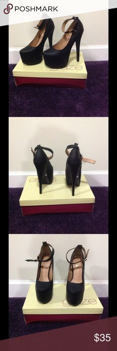 Black platform heels Black leather like platform heel with ankle strap. Very comfortable and stylish. True to size. Feel free to make an offer. Glaze Shoes Heels
