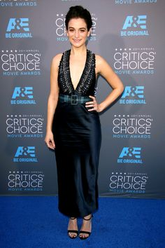 Slaying it....  http://www.refinery29.com/2015/01/80864/critics-choice-outfits#slide-9  Jenny Slate Miu Miu is starting to become a red carpet heavyweight, and Jenny Slate absolutely slays in this prussian-blue dress. The specific ankle length and belt lend the quirk-factor, and the dramatic collar of embellishments lets her go easy on other accessories.