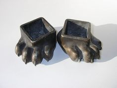 I couldnt take it, had to buy these antique metal bear feet to set my pots on