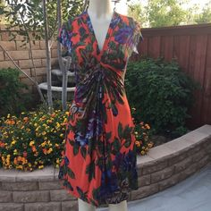 Bright and beautiful dress Gorgeous colorful dress . 100% polyester .  Measurements lying flat small  - Bust :15 waist : 13 length : 38 Medium - Bust :16 waist : 14 length : 38. Dresses
