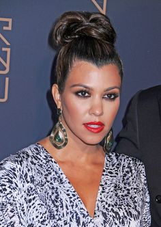 I love Kourtney Kardashian's top knots ALMOST as much as I love her perfect Widow's peak hairline. Yes, I am weird.