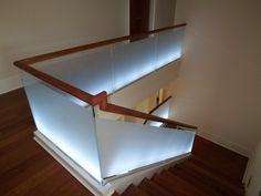 Modern Staircase Design with Glass Railings and Wood Steps