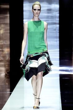 Gucci Spring 2012 Ready to Wear: Flat chested, boyish look to it, columnar shape, dropped and unfitted waist, short hemline, early part of the 20's