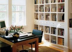 Option #3. OK, imagine this piece (except 4x2 cubes instead of 5x2) as the center of the bookshelf wall, with a Kallax 4x2 unit (also turned sideways) on each side. Add base support and baseboard to raise the height of all the units, build a box with drawers atop the center unit, add molding at top of center unit, and add wood tops on the lower units.