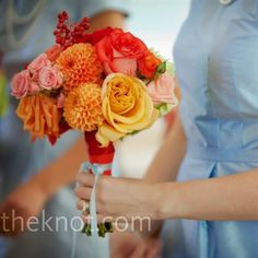 The bridesmaids carried bouquets similar to Rebecca's -- bright bunches of roses, dahlias, viburnum berries, and celosia.