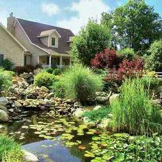 Beautifully landscaped yard w/pond ~