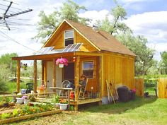 Fully outfitted with solar panels, a wind turbine, a garden, and a solar composter Read more: http://www.motherearthnews.com/green-homes/solar-cabin-in-two-weeks-zm0z14jjzsor.aspx#ixzz3CaJ6q9EYOutside of the Lived-in Solar Cabin