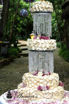 Famous Wedding Cake by Annica's , made with sugar rose petals and crystals