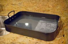 Put warm water into the dirty pan or cookie sheet, lay the dryer sheet (or sheets) flat in the water and leave it to sit overnight. In the morning, the baked-on stuff will either have lifted off, or will be very easy to slough off with a spatula or other flat object. It has always worked for me...especially if you do it right after you've used the pan.