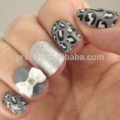 So Fancy! These super fun nails are perfect for a festive occasion. Alternating nails of black/white/gray leopard print, silver glitter, and gray with a white bow and jewel. Available at select Walmart stores nationwide. Leopard Nail Art, Leopard Print Nails, Gray Nails, Artificial Nails, Silver Glitter, Fun Nails, Nail Designs, Bows, Fancy