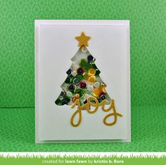 """Oh Christmas Tree shaker card full of sprinkles, how I love thee!  Using green sprinklers in the mix makes this look like a tree full of colorful lights.  The star and """"joy"""" have been embossed in gold."""