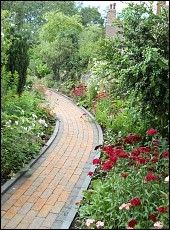 Wheelchair friendly garden path - I would LOVE something like this on our 22 acres in TN, but it needs to be yellow brick! :)