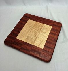 padauk and curly maple cheese board by HartmanWoodworks on Etsy
