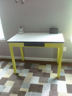 Antique kitchen table w/ white enamel metal top refinished and painted chartreuse. I added a modern, stainless steel handle to the black drawer.