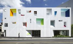 The Sugamo Shinkin Bank Tokiwadai Branch by Emmanuelle Moureaux features a white, aluminium facade punctured by holes that form the shape of a series of trees