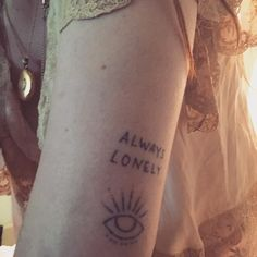 8e1f4d6bc Florence Welch showing her ALWAYS LONELY tattoo Tattoo Quotes, Tattoos,  Tat, Tattoo,