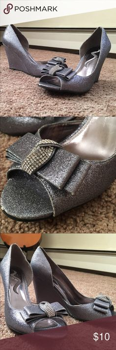 Glitter Wedges Glitter wedges worn once for a wedding. Silver-pale blue color with rhinestone bow accent on toe. Please see photo with wear around edges where some glitter has come off. ***all items come from a pet friendly/smoke free home*** Nina Shoes Wedges