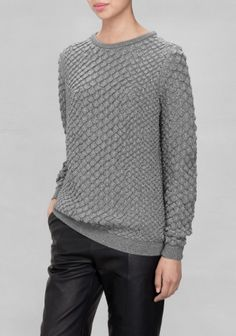 & OTHER STORIES This merino wool sweater has an oversized, relaxed look and a raised knit design with a metallic finish.
