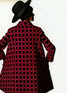 Editha Dussler wearing a check coat for Vogue, 1966. Photo by Irving Penn.