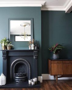 - Home interior Design Living Room Paint Colors - Home interior Design Luxury Beach Houses Dark Living Rooms, Living Room Green, Room Design, House, Home, Black Fireplace, Interior Design, Living Room Designs, Victorian Living Room