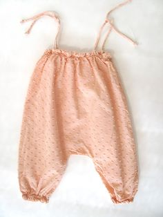 Cute little pink cotton pants for baby girl. They don't look very practical but are adorable.