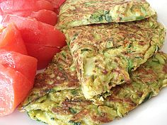 Makes 2 large pancakes, which make 2 main dish servings or 4 appetizer/side dish servings    3 medium zucchini, or about 4 cups shredded  2 zucchini flowers (optional; adds a bit of color)  Some coriander or basil leaves (optional: adds flavor)  1 cup chickpea flour  1 tsp. salt  1 tsp. garam masala  1/2 tsp. hot red chili powder  1/2 tsp. curry powder  Olive oil for cooking