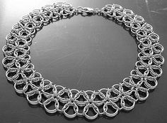 """Stainless steel Celtic Visions 3 Tessellation necklace with crab claw clasp. 19swg with 1/8"""" and 5/32"""" id. 18swg with 5/16"""" and 3/8"""" id."""