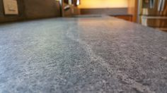 A ton of subtle interest in this soapstone.  My husband was adamant that we purchased this from a local supplier, and we are absolutely thrilled with the countertop.  Unique, elegant and full of character!