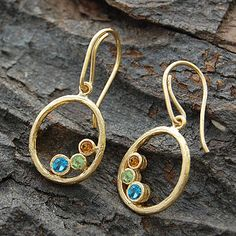 An abstract oval design with hand-set precious and semi-precious faceted stones - this piece defines the Embers ethos - historical references with a modern aesthetic. #Embersjewellery #Jewellery #November #Birthstone #Topaz #Citrine