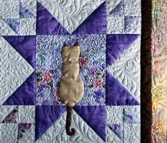 Siamese Cat Quilt - love this, but for me minus the triangles/squares ..... and might like the cat in velvet or even faux fur with a soft mink backing.