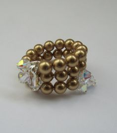Gold Pearl and Crystal Bicone Memory Wire Ring by MoYuenCreations, $8.50 #teamdream #RT Memory Wire Rings, Memory Wire Jewelry, Wire Jewellery, Memory Wire Bracelets, Diy Jewelry, Jewelry Rings, Wire Wrapped Rings, Gold Pearl, Pearl Beads