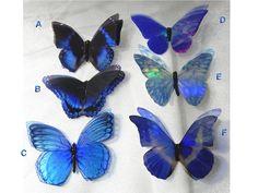 Sparkling blue iridescent resin butterflies