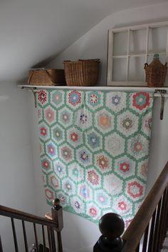 Customizable Closet Rods - A rod through open shelf brackets makes a beautiful vignette from www.SarahandDrewB.blogspot.com