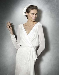 Equally stunning and unique gown from @perfectdayb0752 #wedding #weddingdress #longsleevedress