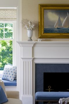 Nautical artwork over fireplace mantel and blue and white themed window seat SLC INTERIORS - Interior Design - White Fireplace, Living Room With Fireplace, Fireplace Design, Fireplace Mantels, Fireplace Ideas, Fireplaces, Classic Fireplace, Fireplace Brick, Fireplace Redo