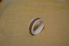 Leather insertion bone ring.