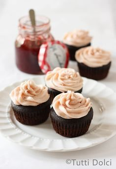 Chocolate-Strawberry Cupcakes - rich devil's food chocolate cupcakes filled with strawberry jam and topped with strawberry buttercream.