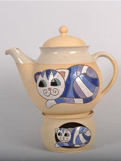 Teapot with candle warmer – a functional piece of art.  Dimensions: 26 cm (10 in) wide, 26 cm tall - £ 35