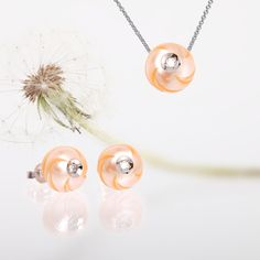 """Pacifica"" style peach hand-carved freshwater Diamond in a Pearl pendant and earrings from Galatea: Jewelry by Artist. Styles 9002WP and 9002EWP. 14k white gold; .04 ct diamond centers."