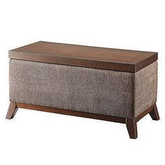 """Add storage and style to any room with the Lift Top Storage Ottoman. Beautifully crafted with a richly hued, wooden frame and banded in neutrally hued fabric, this ottoman can serve as an extra work or eating surface.  Measures 17.5"""" L x 34.75"""" W x 18"""" H"""