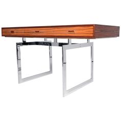 Brazilian Rosewood Desk in the Style of Bodil Kjaer | From a unique collection of antique and modern desks at https://www.1stdibs.com/furniture/storage-case-pieces/desks/