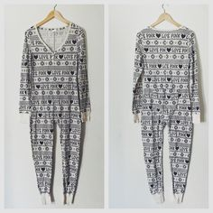 "In great condition! Size medium! Features button up flap at the rear end Fair Isle snowflake and ""Love Pink"" print all over Get a head start on your fall/winter/holiday wear with this popular thermal onesie by VS PINK! Hard to find in this color! Worn in navy blue and white by Ariana Grande in her ""Santa Tell Me"" video. (Note: the one I'm selling is not the same color) ✨Accepting reasonable offers!✨"