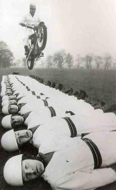 Sergeant Major Tom Gledhill, riding a standard BSA twin motorcycle, leaps over 20 members of the Royal Artillery Motor Bike display team, at 1966 - [[MORE]] Original caption: Sergeant Major. Vintage Bikes, Vintage Motorcycles, Valentino Rossi, Old Photos, Vintage Photos, Vintage Photographs, Moto Scooter, Major Tom, Street Tracker