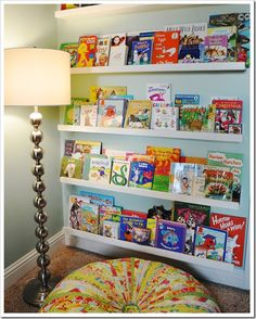 Love this floor cushion (links to tutorial I'll never do, but love nonetheless) and display book shelving for playroom